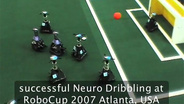 Learning to Dribble on a Real Robot by Success and Failure